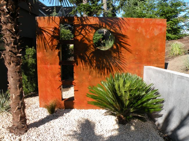 View more about Stained Concrete Garden Accent Wall